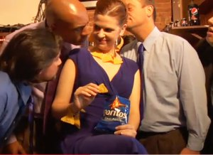 Beautiful woman charming men with her Doritos